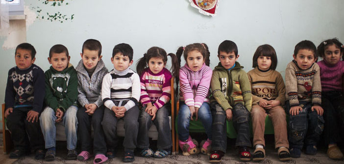 Syrian refugees wait for support